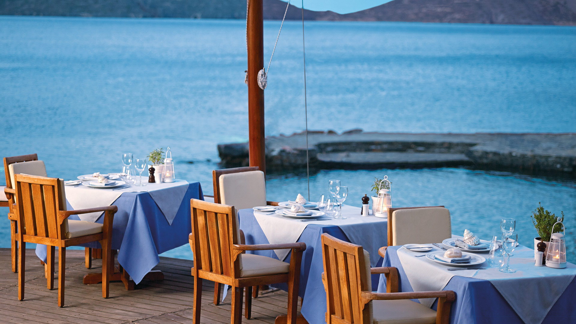 The Yacht Club Restaurant At Elounda Mare Hotel Perched On A Dramatic Edge And Overlooking Beach Below Serves Dinner In Summer Months With